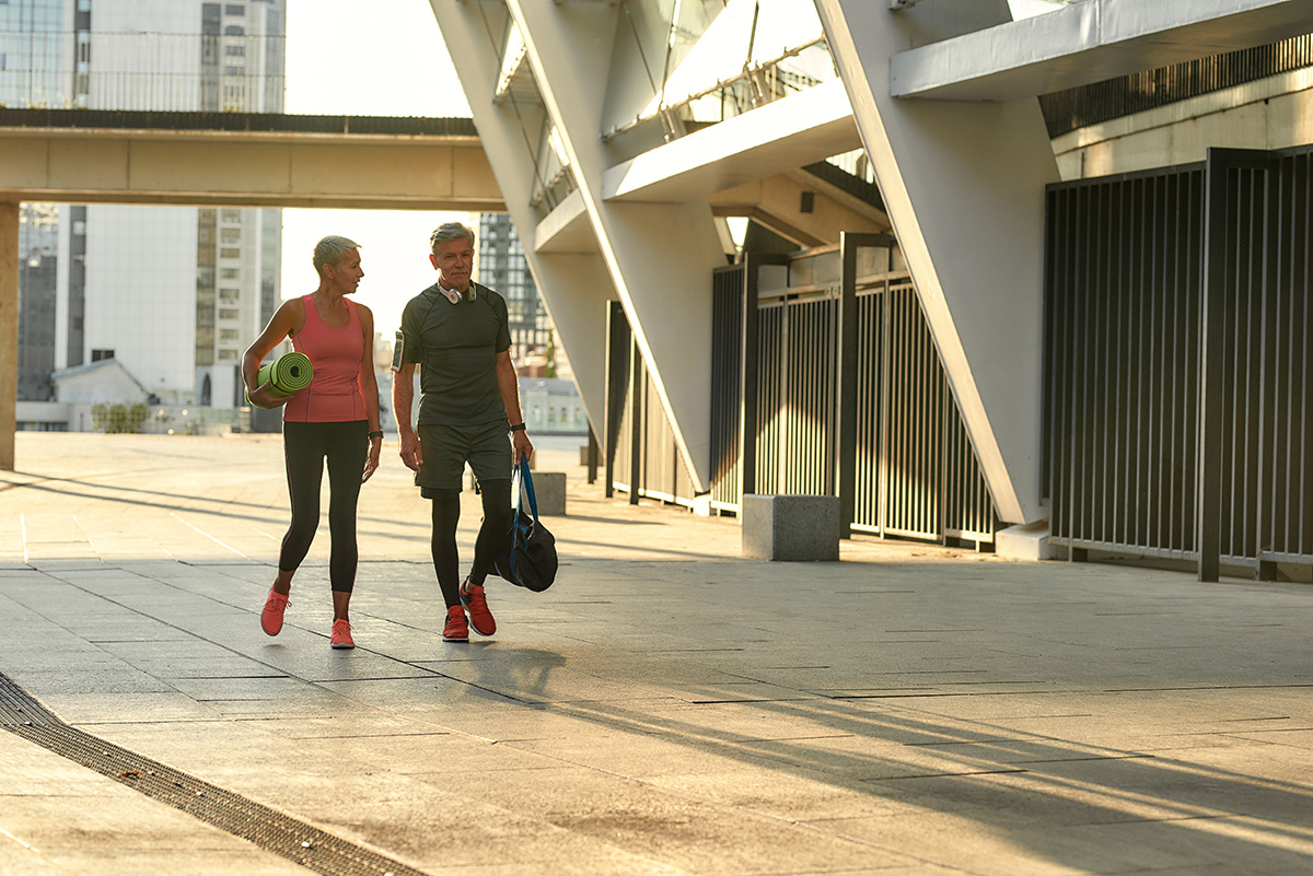 Active life. Senior couple in sports clothing going to exercise together outdoors